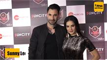 Sunny Leone gives kiss to hubby Daniel Weber