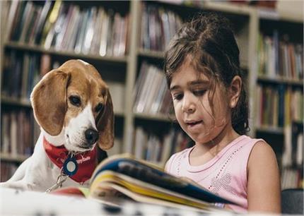 पालतू कुत्तों के साथ बढ़ती है बच्चों के पढ़ने की क्षमता: रिसर्च