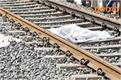 women commit suicide by jumping ahead of train