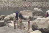 two children flowed in river bhagirathi while playing cricket