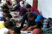 photographs of students taking exams in bihar