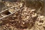 two laborers buried by a hill fall