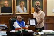 social service agency swabhiman has been honored by governor solanki
