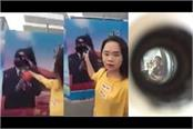 chinese women throwing inks on shi s poster