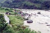 people bathing in the ravine here