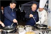putin treats china s leader to pancakes vodka at forum