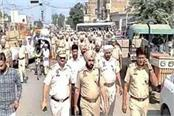 punjab police and bsf carry out joint flag march