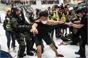 hong kong democracy activist injured in knife attack