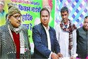 palwal market committee distributed checks to farmers