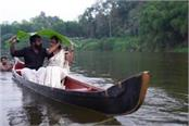pre wedding photoshoot couple fall from boat