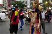 yamraj descended on the road towards corona making people aware and say