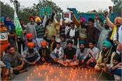 on guru nanak jayanti protesting farmers lit lamps at the singhu border