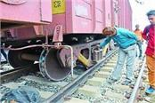 half a dozen coaches of the goods train were emptied many trains were late