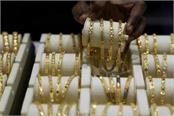 gold and silver fall slightly