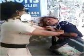 breaking news woman abuses beat up lady police
