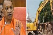 bulldozers run over 200 shops of gorakhnath temple after orders from cm