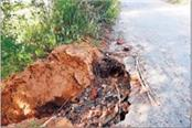 driver upset due to road erosion