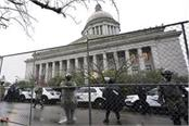 us state capitals tighten security amid threat of armed protests