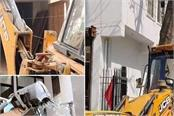 dtp department takes action on illegal construction jcb runs on dozens of flats