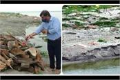 in the midst of the rising water level of the ganges the corpses