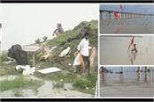 flood threat looming in prayagraj due to rise in water level of ganga yamuna