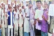 mnrega workers protest against sarpanch
