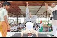 farmers did yoga in protest headstand done at khatkar toll plaza