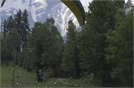in this snow covered district for 6 months tourists enjoy paragliding