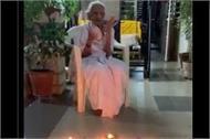 heeraben celebrates ram temple land worship in ayodhya by lighting a lamp