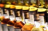 वैशाली में छापेमारी के दौरान 690 कार्टन विदेशी शराब बरामद, 8 लोग गिरफ्तार