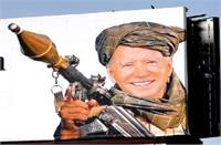 US में तालिबानी गेटअप में राकेट लांचर लिए दिखे बाइडेन, होर्डिंग पर लिखा शर्मनाक संदेश ! (PICS)