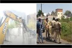 azam khan s close aide bulldozer fired on former co ale hassan building