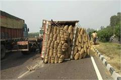 overload truck reflexed in highway