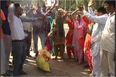 teachers in front of the small secretariat celebrate black diwali