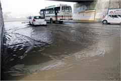 the underpass of the highway remains a dump of dirty water