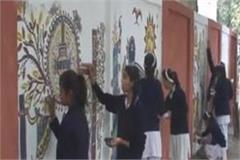 school children are writing new articles painting giving message to keep clean