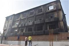 fire brigade s sweat to control fire in closed factory
