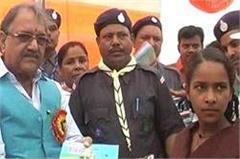 books and uniforms distributed among students yogi government