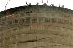parl investor climbed water tank