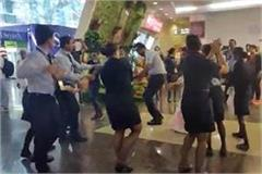 video when pilots and air hostesses leave work and garba at the airport