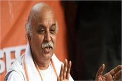 pm modi is busy worrying about nita s husband instead of sita togadia