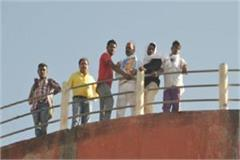 councilor on tanker like sholay veeru threatened to jump if demand is not met