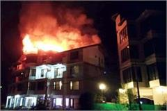 fire in the top floor of the hotel in midnight