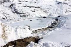 movement of vehicles running between light snow in rohtang pass