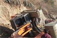 jcb falls on the road