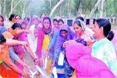 anganwadi workers lit the cm copies of agreement