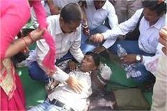 students who are protesting against government are unconscious in heat