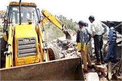 jcb run on illegal shop on forest land