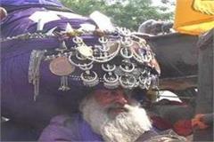 nihang sikh riding a horse during the baisakhi