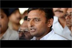 akhilesh gets bigger blow sp leader nitish kumar joins 50 supporters in bjp